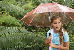 Girl Holding Umbrella In Forest Stock Photography