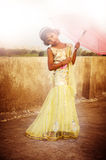Girl holding umbrella in gown Royalty Free Stock Images