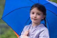 Girl holding umbrella Stock Photo