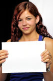 Girl Holding Up a Blank Card Stock Image