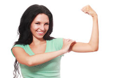 Girl is holding up her muscles Royalty Free Stock Photography