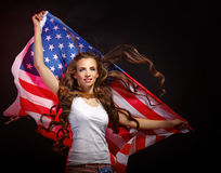 Girl holding US flag waving Royalty Free Stock Photo