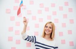 Girl holding USA flag Stock Images