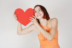 Girl holding valentine heart card Royalty Free Stock Images