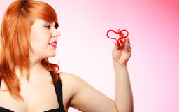 Girl holding valentine red heart love symbol. Valentines day. Stock Images