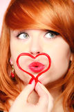 Girl holding valentine red heart love symbol. Valentines day. Stock Photography