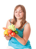 Girl holding vegetables Royalty Free Stock Image