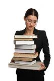 Girl holding very large pile of books Royalty Free Stock Photos