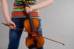 Girl holding violin Stock Photos