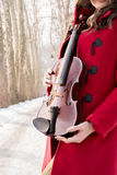 Girl holding violine in hands. Beautiful young girl playing violin royalty free stock photo