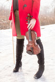Girl holding violine in hands royalty free stock image