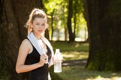 Girl holding water bottle Stock Images