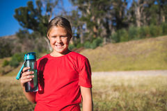 Girl holding a water bottle in the boot camp Stock Photos