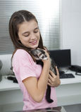Girl Holding Weasel In Veterinary Stock Photography