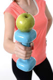 Girl holding weight and apple healthy nutrition Stock Images