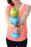Girl holding weight and apple healthy nutrition Royalty Free Stock Image