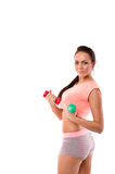 Girl holding weights Stock Image
