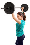 Girl holding weights up Royalty Free Stock Image