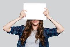 Girl holding white billboard Royalty Free Stock Photo