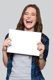 Girl holding white billboard Stock Image