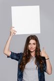 Girl holding white billboard Royalty Free Stock Photography