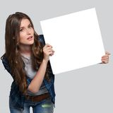 Girl holding white billboard Royalty Free Stock Image
