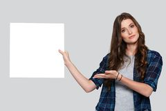 Girl holding white billboard Royalty Free Stock Images