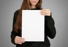 Girl holding white A4 blank paper. Leaflet presentation. Pamphlet hold hands. Woman show clear offset paper. Sheet template. Book. Let design sheet display read royalty free stock photography