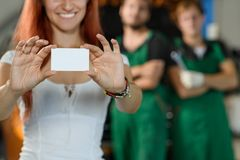 The girl is holding a white box with auto parts in her hands royalty free stock photos