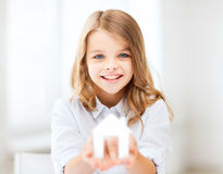 Girl holding white paper house Stock Photo