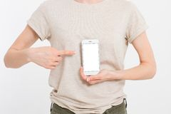 Girl holding white phone. Cellphone isolated on white clipping path inside. Online shopping. Top view.Mock up.Copy space.Template. Blank stock photography