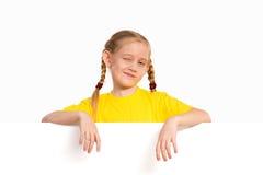 Girl holding white poster royalty free stock photo