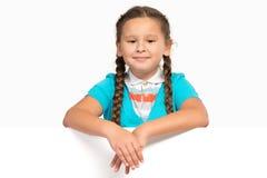 Girl holding white poster stock photos