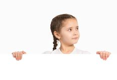 Girl holding white poster stock photography