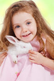 Girl holding white rabbit Royalty Free Stock Photography