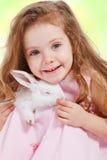 Girl holding white rabbit. Portrait of a preschool girl holding white rabbit Royalty Free Stock Photography