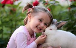 Girl Holding White Rabbit during Daytime Royalty Free Stock Photography