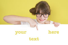Girl holding a white sheet with space for text. Stock Photo
