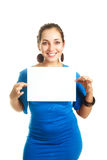 Girl holding a white shit of paper Stock Photo