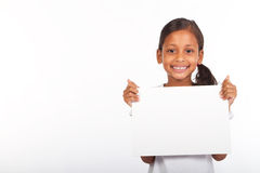 Girl holding whiteboard. A pretty young indian girl holding a blank whiteboard on white background Stock Photos