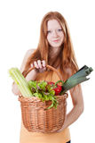 Girl holding wicker basket with vegetables Royalty Free Stock Photos