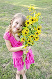 Girl holding wildflowers Royalty Free Stock Image