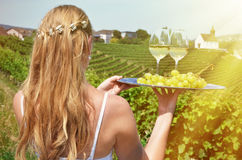 Girl holding wine and grapes on the plate Stock Photography