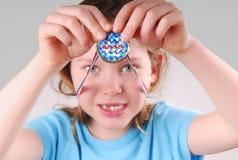 Girl Holding Winner Medal. Young girl happily holding up Winner Medal Stock Images