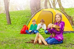 Girl holding the wood for bonfire during camping Royalty Free Stock Photos