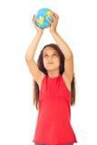 Girl holding world globe in her hands Stock Photos
