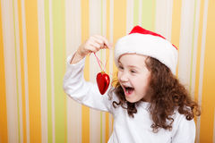 Girl holding xmas tree toy Stock Photography