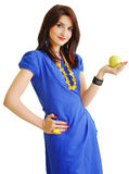 Girl holding a yellow apple Stock Photo