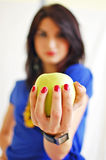 Girl holding a yellow apple Royalty Free Stock Photos