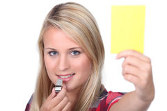 Girl holding a yellow card Royalty Free Stock Photo